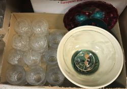 Two boxes containing assorted glassware to include tumblers, high balls, etc, a glass fruit bowl, an