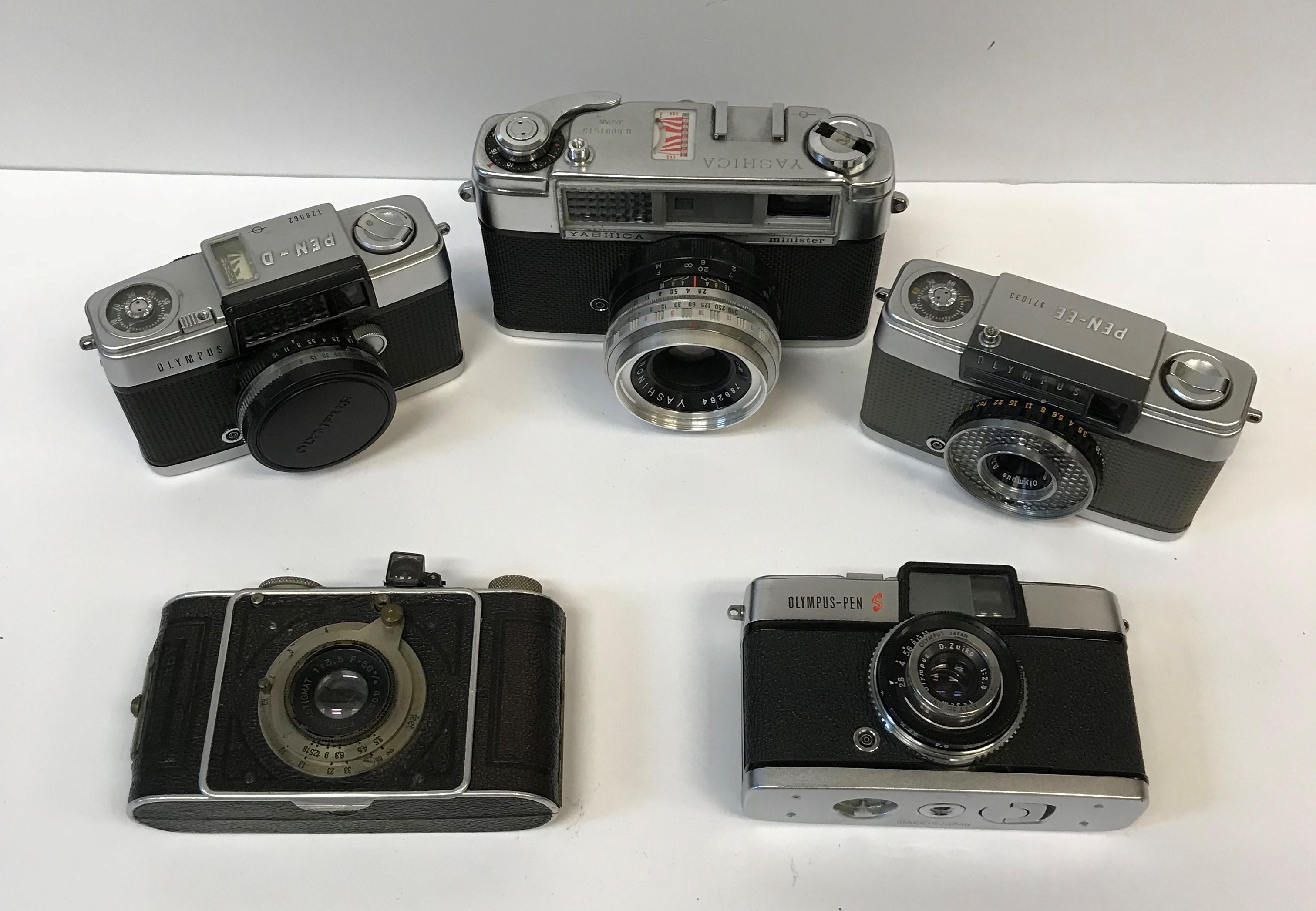 A collection of six various cameras including an Edixa 16-S mini camera, an Olympus Pen-D camera,