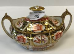 """A circa 1830 Spode """"Japan"""" pattern sucrier of oval form with open handles, inscribed to base """""""
