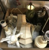 Three boxes of assorted sundry items to include various table lamps, cushions and a Victorian