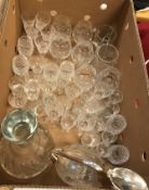 Three boxes of assorted glassware to include decanters, wine glasses, serving plates, etc,