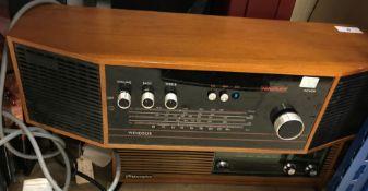 A Hacker case with Garrard record player, Murphy radio and Hacker oak cased radio, vintage Remington