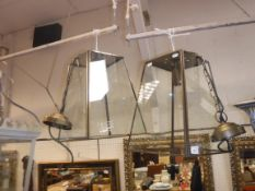 A set of three metal bound and glass square tapering hall lanterns, approx 36 cm long
