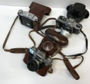 A box of various cameras, all cased, to include a Zeiss Ikon, a Solida III, an Agilux Agimatic, Agfa