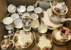"""A collection of Royal Albert """"Old Country Roses"""" tea wares to include mugs, teacups, cake plates,"""