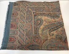 A large cotton shawl of Persian carpet style design, the centre medallion on a pale blue scrolling