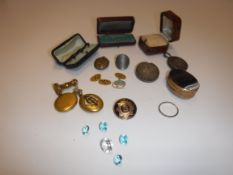 A collection of various items of jewellery and objets de vertus including a 9 carat gold