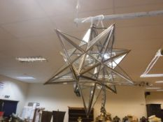 A modern glass and metal bound hall lantern of starburst form, approx 46 cm long