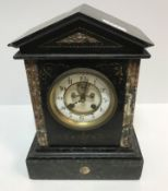 A 19th Century French marble and slate cased mantel clock of architectural form, the eight day