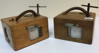 Two oak cased Benzing racing pigeon clocks, 21 cm x 16.5 cm x 13 cm high