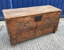 """An 18th Century oak hutch, the plank top over a foliate medallion carved front panel inscribed """"S"""