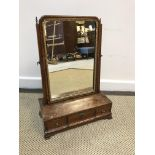 A 19th Century mahogany and barber pole strung toilet mirror, the shallow dome top plate with carved