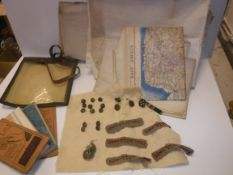 A collection of militaria to include Women's Transport Service F.A.N.Y (First Aid Nursing