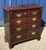 A mahogany batchelors chest in the George III manner, the plain top with moulded edge over a