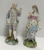 A pair of Derby-style figures of a gentleman and woman in mob cap, damaged and restored to the shell
