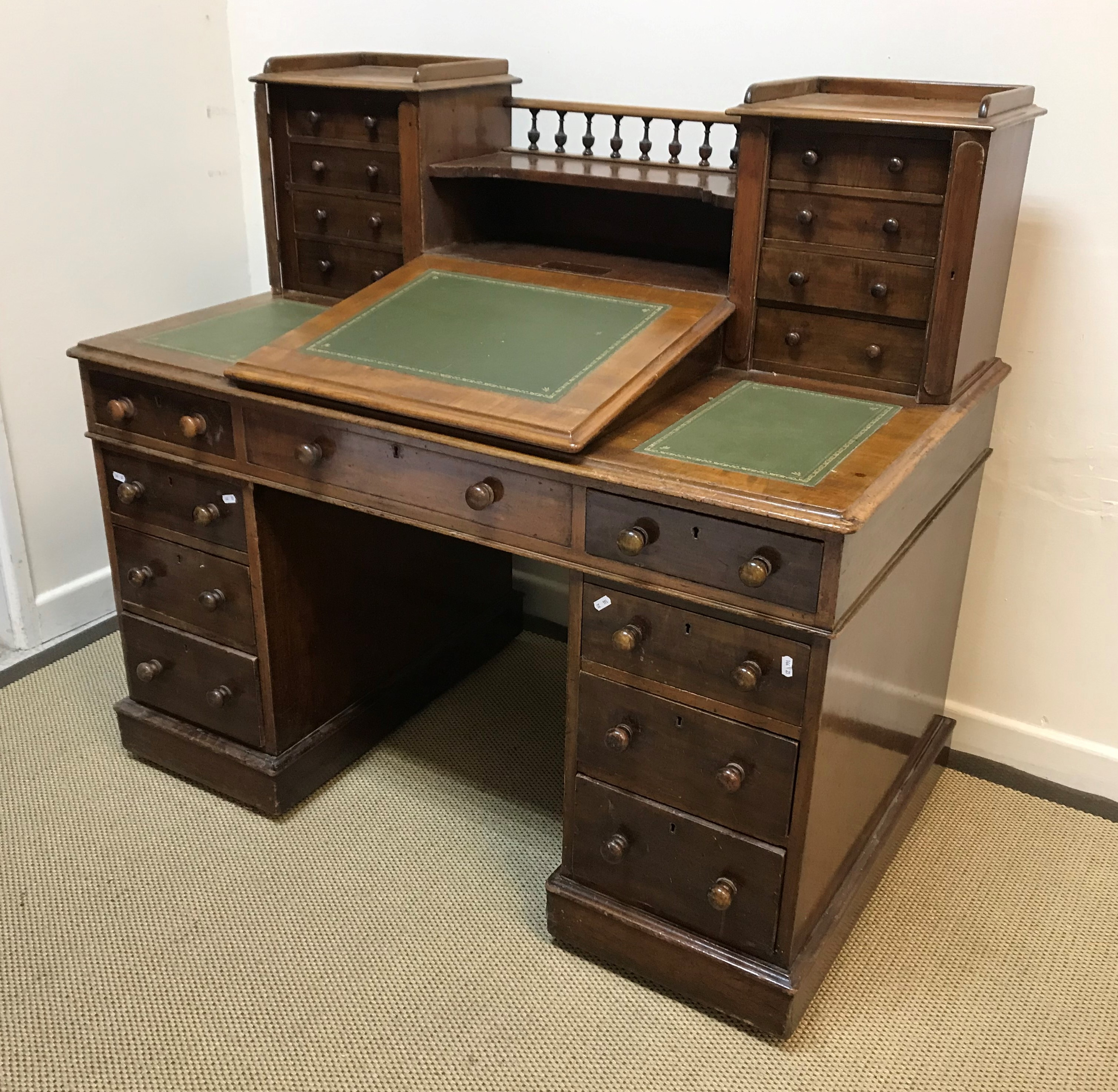 """A late Victorian mahogany """"Dickens"""" desk, the superstructure with central writing slope flanked by"""