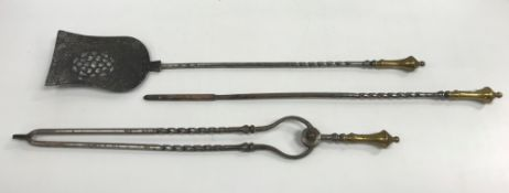 A set of three late 18th / early 19th Century brass-handled iron fireside tools of barley-twist