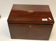 A Victorian mahogany stationery box, the sloping top opening to reveal a fitted interior over two
