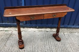 A 19th Century mahogany washstand with three quarter galleried top over two drawers on square