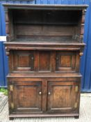 An 18th Century oak tridarn, the upper section with panelled sides and turned column supports over a