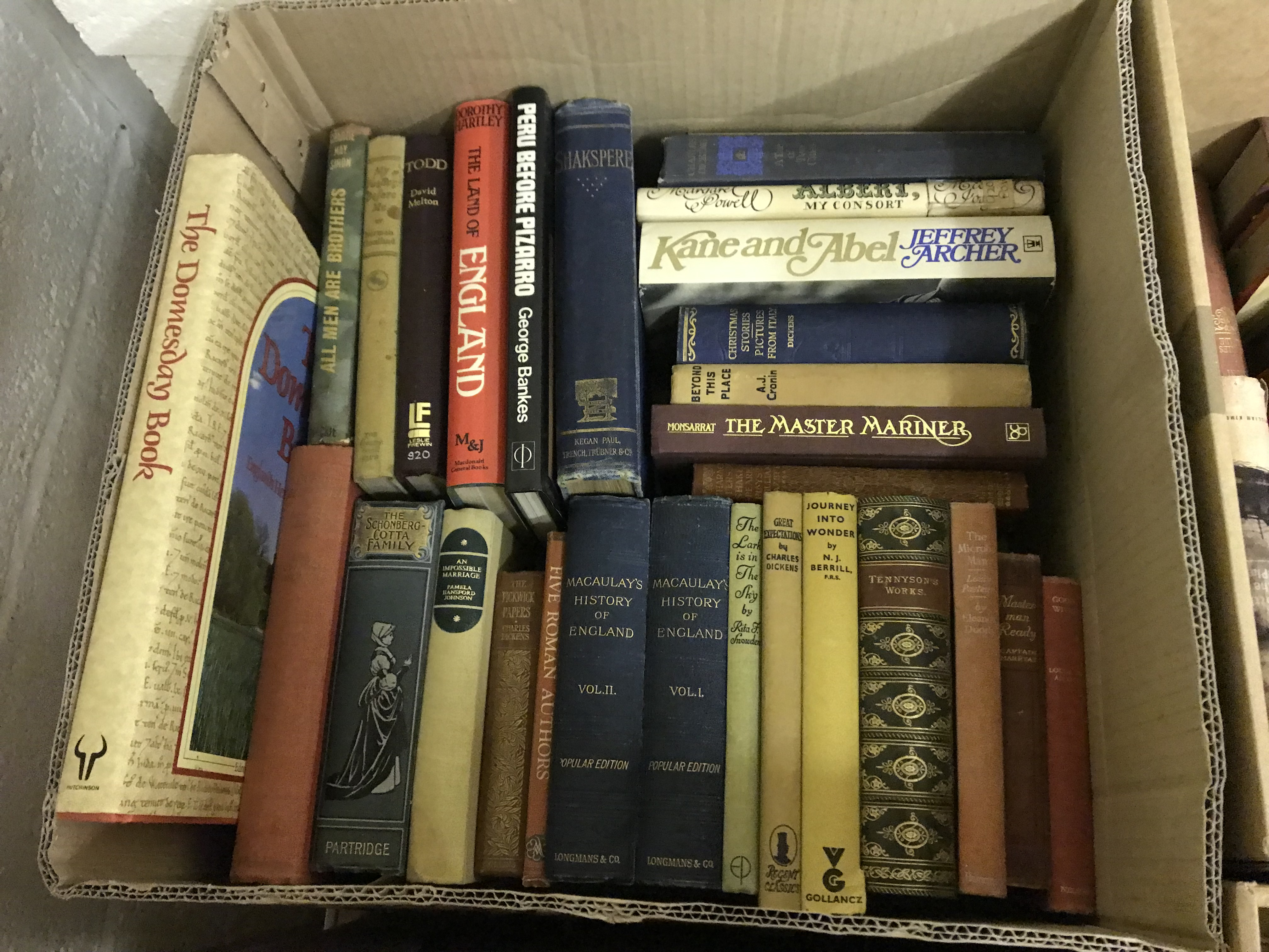 Eleven boxes of assorted books, mainly novels or historical subjects