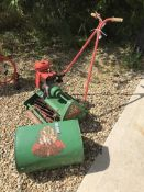 A Suffolk Super Punch Dual Drive petrol driven cylinder lawnmower with grass catcher