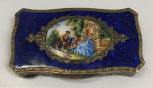 An 19th Century silver gilt and enamel decorated snuff box in the Louis XV style, the top