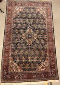 A Kashan carpet, the central panel set with floral decorated medallion on a dark blue hook decorated