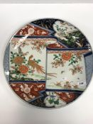 A circa 1900 Japanese Imari charger, the centre field decorated with folded scroll depicting a