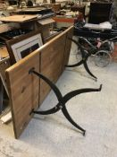 A modern pine rectangular dining table on scrollwork iron supports 200 cm x 90 cm