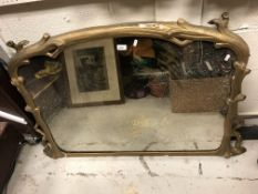A Victorian gilt framed overmantel mirror of coppiced branch form enclosing a dome top plate, 125 cm