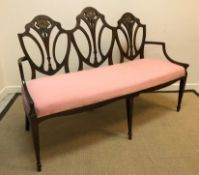 A circa 1900 mahogany and painted three seat salon settee in the Sheraton Revival taste, the