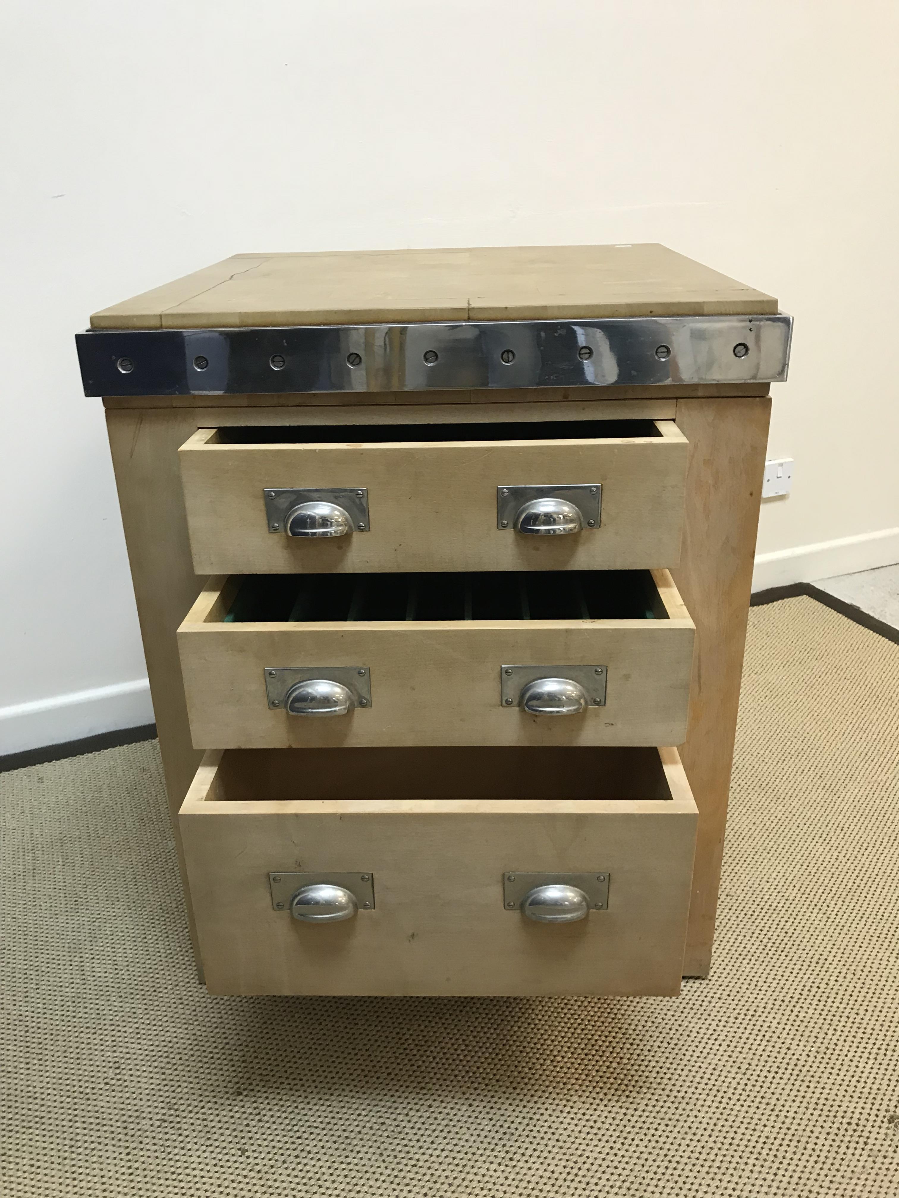 A modern metal bound wooden kitchen island / butcher's block with three drawers, 69.5 cm wide x 69