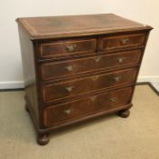 A walnut chest in the early 18th Century manner, the double quartered top cross-banded and with