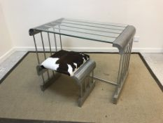 A mid to late 20th Century aluminium rod constructed glass top table with curved single piece ends