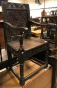 A 17th Century oak Wainscott type chair, the lunette carved top rail over a foliate medallion