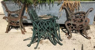 A pair of modern cast bench end together with another pair of bench ends and two matching pairs of