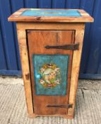 A Continental pine single door cupboard, the top and door painted with panels of flowers on a blue