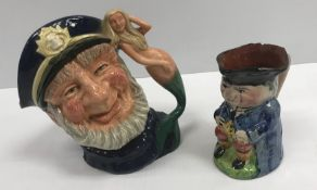 """A box containing a collection of various character jugs including Royal Doulton """"Old Salt"""""""