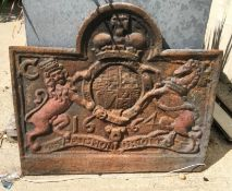 """A cast iron fire back with lion and unicorn motifs and dated 1664, initialled """"CR"""" to corners, 74 cm"""