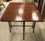 An Edwardian satinwood and barber pole strung drop-leaf Sutherland table on square collared supports