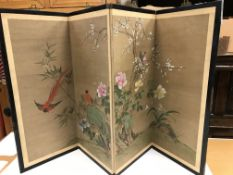 A Chinese hand-painted fabric panelled four-fold screen decorated with exotic birds amongst prunus