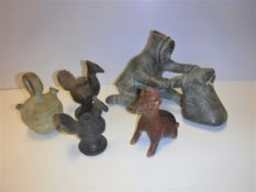 A collection of various pre-Colombian style pottery including a red slip bottle as a cat or dog with