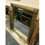 A modern Victorian style reeded gilt framed wall mirror with floral medallion corners, 92 cm x 118