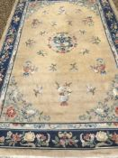 A Chinese Superwash rug, the central panel set with dragon motif on a gold ground, set with floral