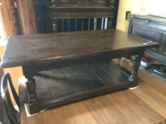 A Titmarsh & Goodwin oak coffee table in the 18th Century manner, the plank top on turned supports