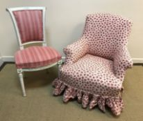 A Victorian upholstered scroll arm chair on turned front legs, a Scandinavian style painted scroll