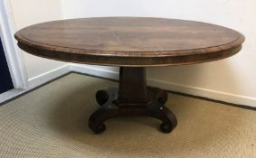 A Victorian rosewood centre table, the oval top with moulded edge above a plain frieze on tapering