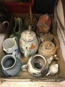 Three boxes of assorted decorative china wares to include assorted stoneware flagons / storage jars,
