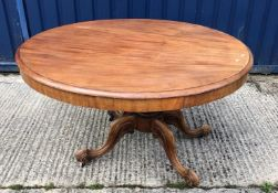 A Victorian mahogany breakfast table, the snap top on a turned and reeded pedestal to moulded
